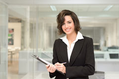 Businesswoman in modern office interior Stock Images
