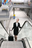 Businesswoman in modern train station hall Stock Photography