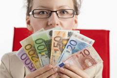 Businesswoman with money Stock Images