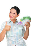 Businesswoman with money giving thumbs up Royalty Free Stock Photo