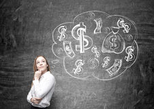 Businesswoman with money on mind Royalty Free Stock Photos