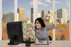 Businesswoman with money on monitor Royalty Free Stock Photography