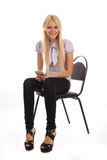 Businesswoman with money on office chair Stock Image