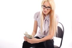 Businesswoman with money on office chair Stock Photo
