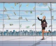 Businesswoman and money rain Royalty Free Stock Image