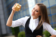 Businesswoman with moneybox Stock Photos
