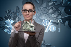 The businesswoman in mortgage business concept Stock Images