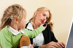 Businesswoman and mother cannot take it all Royalty Free Stock Photography