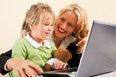 Businesswoman and mother showing kid the internet royalty free stock images