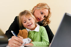 Businesswoman and mother is working at home Royalty Free Stock Photography