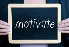Businesswoman with motivate sign Stock Images