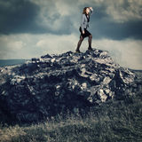 Businesswoman on a mountain top Royalty Free Stock Photography