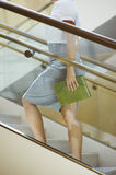 Businesswoman Moving Up Stairs Stock Image