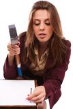 Businesswoman nailing the contract. Businesswoman with hammer nailing a contract, conceptual shot Royalty Free Stock Image