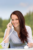 Businesswoman in nature attractive smile calling Royalty Free Stock Photos