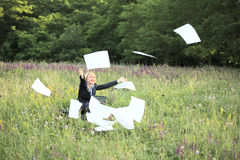 Businesswoman on nature catch documents. Businesswoman on nature with laptop catch documents Stock Image