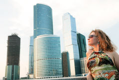 Businesswoman near modern buildings Royalty Free Stock Image