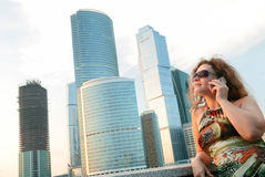 Businesswoman near modern buildings Royalty Free Stock Images