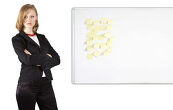 Businesswoman near whiteboard Royalty Free Stock Photos