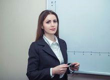 Businesswoman near whiteboard Stock Image