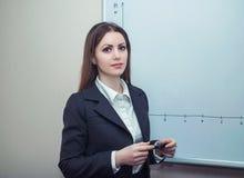 Businesswoman near whiteboard Stock Image
