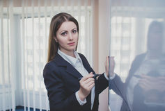 Businesswoman near whiteboard Stock Photo