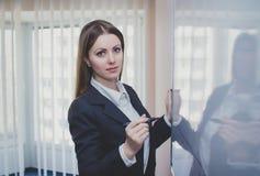 Businesswoman near whiteboard Stock Photo