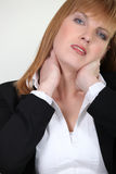 Businesswoman with neck ache Royalty Free Stock Photography