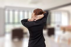 Businesswoman neck pain while standing at office - office syndrome concept. Businesswoman neck pain while standing at office - office syndrome concept royalty free stock images