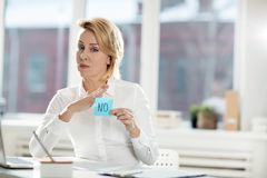 Disagreement. Businesswoman with negation sticker prohibiting to do something in office Royalty Free Stock Photography