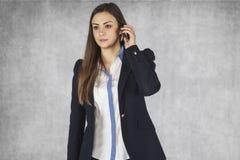 Businesswoman negotiates by phone Stock Photos