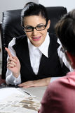Businesswoman negotiating. Businesswoman  and businessman negotiating with competitors in office Stock Images