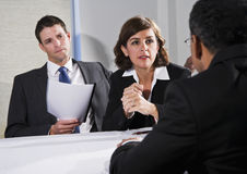 Businesswoman negotiating with men. Diverse business people conversing and negotiating, focus on businesswoman, 40s Stock Photos