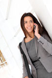 Businesswoman negotiating on phone Royalty Free Stock Photos