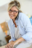 Businesswoman negotiating on the phone Stock Image