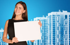 Businesswoman with new houses Royalty Free Stock Photography