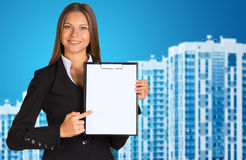 Businesswoman with new houses Stock Photos