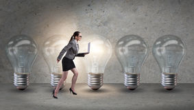 The businesswoman in new idea concept with light bulb. Businesswoman in new idea concept with light bulb Stock Image