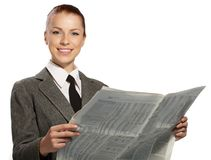 Businesswoman with newspaper Stock Image