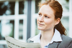 Businesswoman with Newspaper Stock Photography