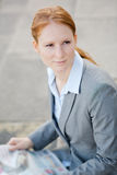 Businesswoman with Newspaper Royalty Free Stock Photos