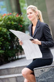 Businesswoman with newspapers Royalty Free Stock Photography
