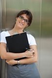 Businesswoman next to the elevator Royalty Free Stock Photo