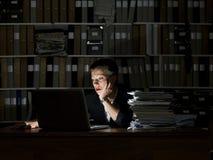 Businesswoman at night Stock Photo