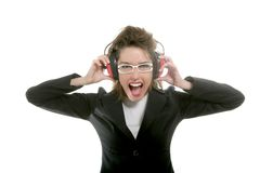 Businesswoman with noise safety headphones. And expression stock photos