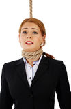 Businesswoman with noose around her neck Stock Photos