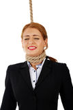 Businesswoman with noose around her neck Stock Images