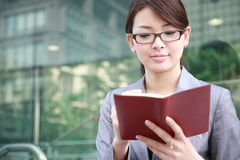 Businesswoman with notebook Royalty Free Stock Image