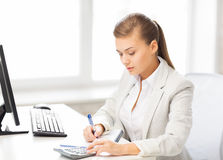 Businesswoman with notebook and calculator Stock Photography