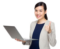 Businesswoman with notebook computer and thumb up Royalty Free Stock Photos